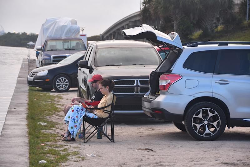 Matt Ward and Emma O'Halloran from Orlando parked next to the Beachline around 7:30. People started showing up at dawn to view the launch of the SpaceX Crew Dragon to the International Space Station.