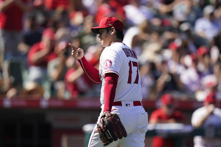 Los Angeles Angels starting pitcher Shohei Ohtani points to catcher Max Stassi after the sixth inning of a baseball game against the Oakland Athletics, Sunday, Sept. 19, 2021, in Anaheim, Calif. (AP Photo/Jae C. Hong)