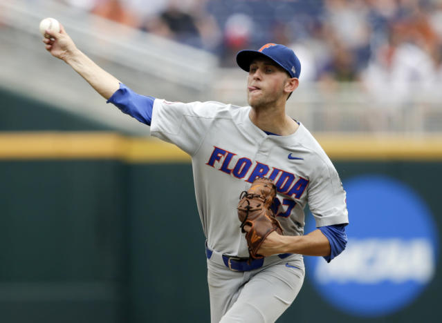 Florida pitcher Jackson Kowar (37) delivers against Texas in the fourth inning of an NCAA College World Series baseball elimination game in Omaha, Neb., Tuesday, June 19, 2018. (AP Photo/Nati Harnik)