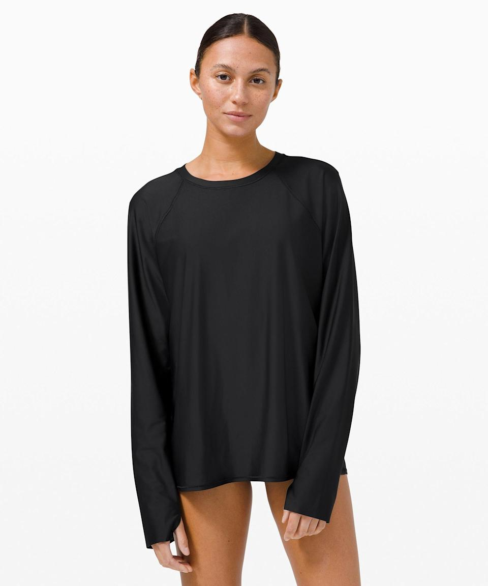 """<p><strong>Lululemon</strong></p><p>lululemon.com</p><p><strong>$78.00</strong></p><p><a href=""""https://go.redirectingat.com?id=74968X1596630&url=https%3A%2F%2Fshop.lululemon.com%2Fp%2Ftops-swim%2FWaterside-Relaxed-UVP-Long-Sleeve%2F_%2Fprod10370215&sref=https%3A%2F%2Fwww.womenshealthmag.com%2Flife%2Fg36686668%2Fbest-swimsuit-cover-ups%2F"""" rel=""""nofollow noopener"""" target=""""_blank"""" data-ylk=""""slk:Shop Now"""" class=""""link rapid-noclick-resp"""">Shop Now</a></p><p>Made with Lululemon's signature barely-there fabric, this is actually totally waterproof and features air back panels that'll seamlessly take you in and out of the water if you're looking for more coverage during your swim workouts.</p>"""
