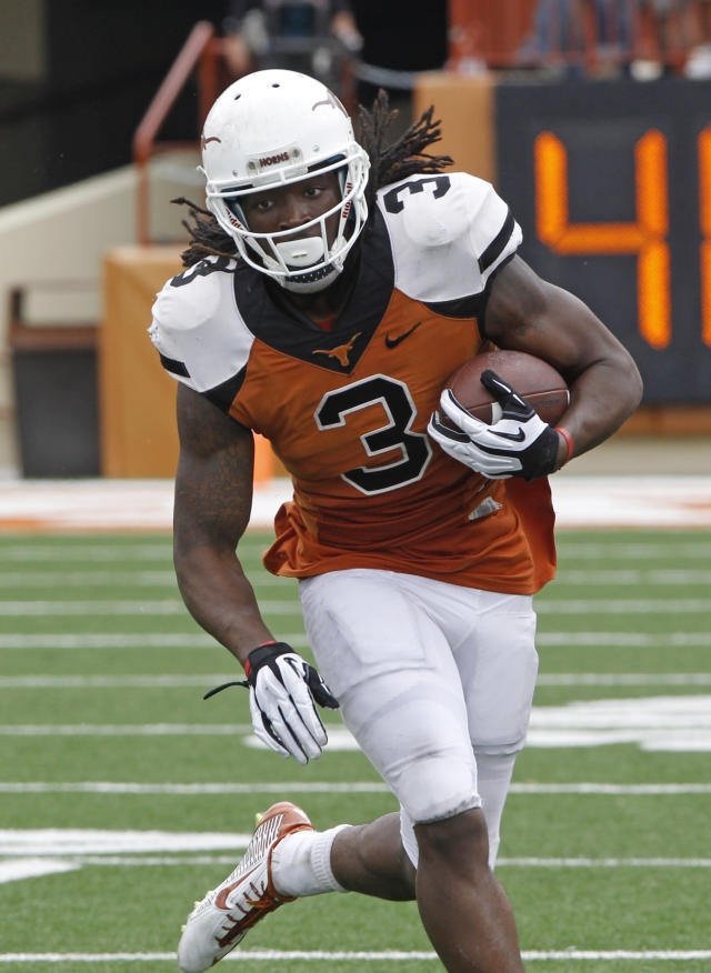 Texas running back Jalen Overstreet (3) runs the ball during the second half of the Orange and White spring NCAA college football game on Saturday, April 19, 2014, in Austin, Texas. (AP Photo/Michael Thomas)