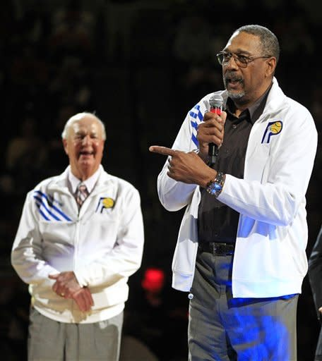 """Indiana Pacers Hall of Famer Mels Daniels, right, speaks as coach Bobby """"Slick"""" Leonard listens during a ceremony honoring Daniels and the ABA championship teams during halftime of an NBA basketball game between the Pacers and Chicago Bulls, Wednesday, April 25, 2012, in Indianapolis. (AP Photo/Darron Cummings)"""