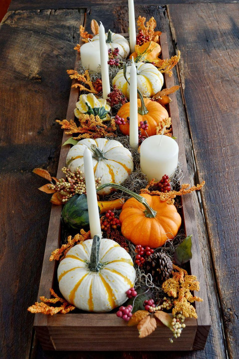 """<p>This gourd-geous piece has it all. Pumpkins, berries, leaves, and a variety of candles work together to add color and some ambience to your holiday table.</p><p><strong>Get the tutorial at <a href=""""http://724southhouse.blogspot.com/2013/09/dressing-up-your-table-for-fall.html"""" rel=""""nofollow noopener"""" target=""""_blank"""" data-ylk=""""slk:724 South House"""" class=""""link rapid-noclick-resp"""">724 South House</a>.</strong></p><p><strong><a class=""""link rapid-noclick-resp"""" href=""""https://www.amazon.com/MyGift-Country-Succulent-Planters-Windowsill/dp/B0722HXHKS/?tag=syn-yahoo-20&ascsubtag=%5Bartid%7C10050.g.2130%5Bsrc%7Cyahoo-us"""" rel=""""nofollow noopener"""" target=""""_blank"""" data-ylk=""""slk:SHOP RUSTIC PLANTERS"""">SHOP RUSTIC PLANTERS</a><br></strong></p>"""
