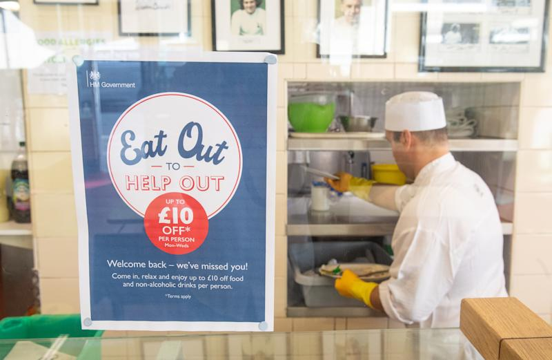 Signage for the 'Eat Out to Help Out' scheme, at the Regency Cafe, in London, one of the participating restaurants where diners will be able to enjoy half-price meals, starting on Monday as the Government kick-starts its August scheme aimed at boosting restaurant and pub trade following the lockdown.