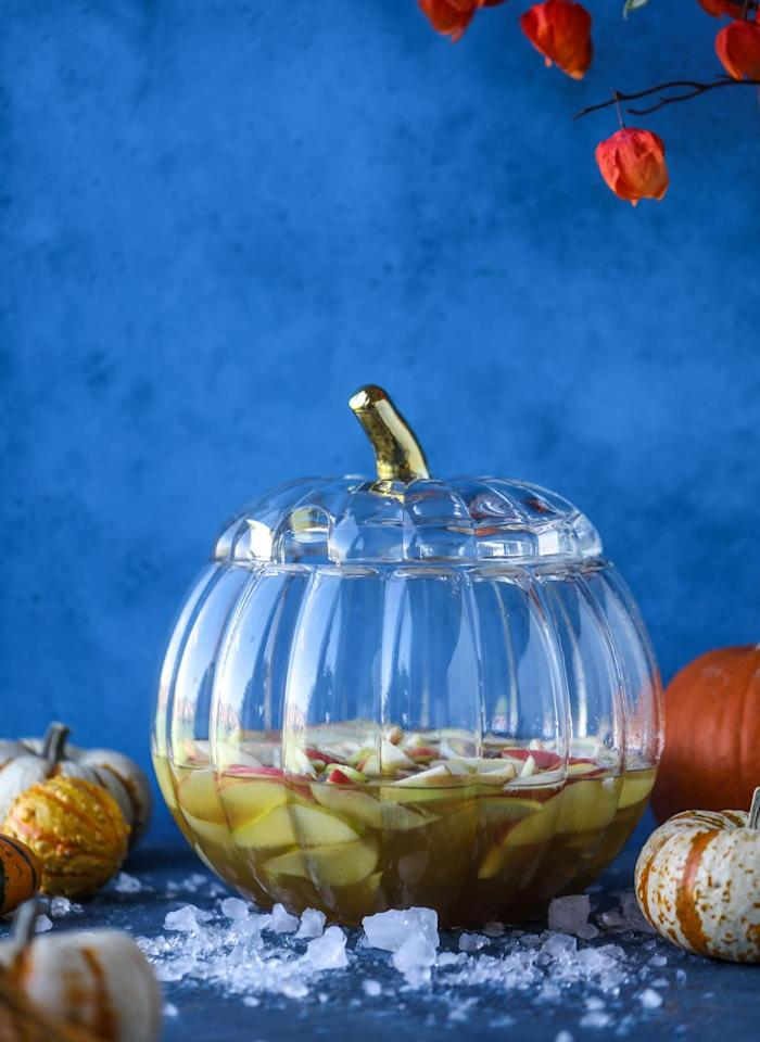 "<p>Combining the ultimate Fall flavor with a classic punch, <a href=""http://www.howsweeteats.com/2018/10/pumpkin-sangria/"" target=""_blank"" class=""ga-track"" data-ga-category=""Related"" data-ga-label=""http://www.howsweeteats.com/2018/10/pumpkin-sangria/"" data-ga-action=""In-Line Links"">this recipe</a> will make a sweet addition to any <a class=""sugar-inline-link ga-track"" title=""Latest photos and news for Halloween"" href=""https://www.popsugar.com/Halloween"" target=""_blank"" data-ga-category=""Related"" data-ga-label=""https://www.popsugar.com/Halloween"" data-ga-action=""&lt;-related-&gt; Links"">Halloween</a> party.</p>"