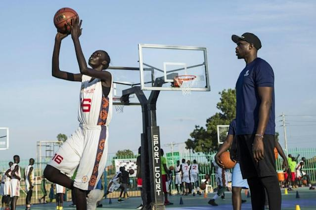 British NBA standout Luol Deng, at right in South Sudan helping train young players, retired from the NBA on Thursday after signing a one-day contract with the team where he made his league debut, the Chicago Bulls (AFP Photo/Akuot Chol)