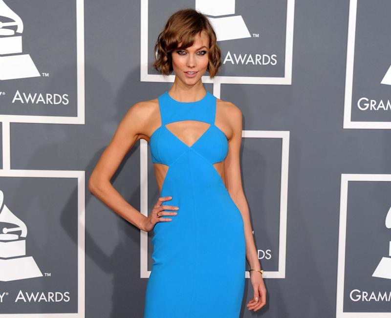 FILE - This Feb. 10, 2013 file photo shows model Karlie Kloss at the 55th annual Grammy Awards in Los Angeles. Kloss is a favorite finale model, closing the catwalk again Wednesday at Michael Kors at New York Fashion Week. She did the same the night before, escorting Oscar de la Renta for his bow. It's these close ties to fashion designers that had put her on the red-eye after the Grammy Awards on Sunday, so she could make it Carolina Herrera's runway bright and early the next morning. (Photo by Jordan Strauss/Invision/AP, file)