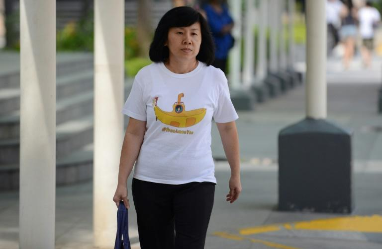 Mary Toh Ai Buay, the mother of teenage blogger Amos Yee, who made online attacks on late former leader Lee Kuan Yew, arrives at the state court to attend her son's hearing in Singapore on July 6, 2015