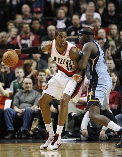 Portland Trail Blazers' LaMarcus Aldridge (12) goes to the basket as Memphis Grizzlies' Zach Randolph, right, defends during the first quarter of an NBA basketball game Thursday, March 22, 2012, in Portland, Ore. (AP Photo/Rick Bowmer)