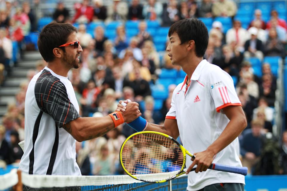 LONDON, ENGLAND - JUNE 15:  Janko Tipsarevic of Serbia (L) congratulates Yen-Hsun Lu of Taiwan after their mens singles third round match against on day five of the AEGON Championships at Queens Club on June 15, 2012 in London, England.  (Photo by Clive Brunskill/Getty Images)