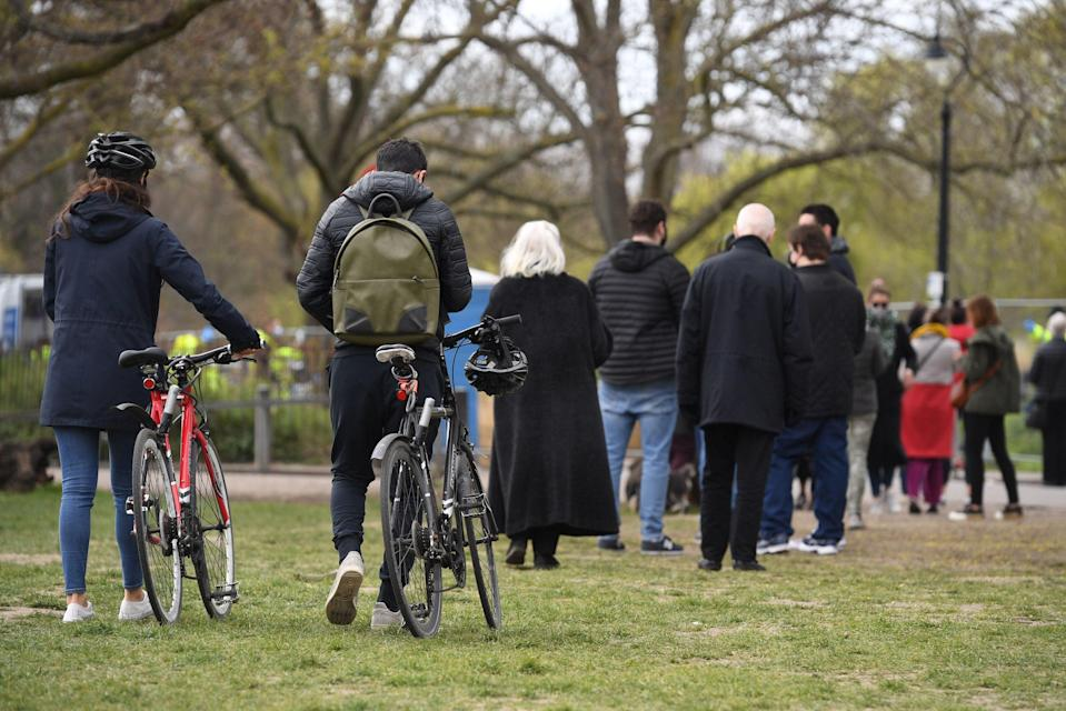 People stand in line for coronavirus surge testing on Clapham Common, south London (PA)