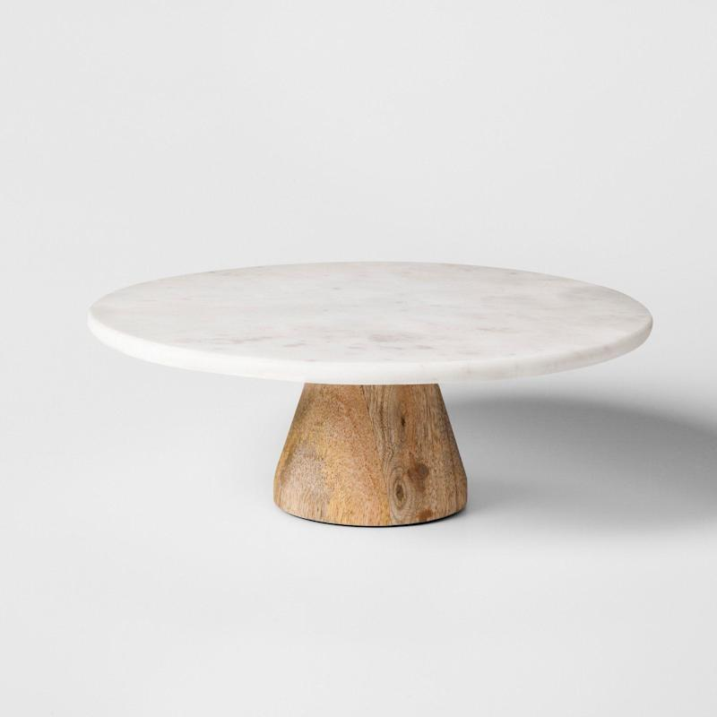 """<a href=""""https://www.target.com/p/marble-acacia-cake-stand-project-62-153/-/A-52262782#lnk=newtab"""" target=""""_blank"""">Shop it here</a>."""