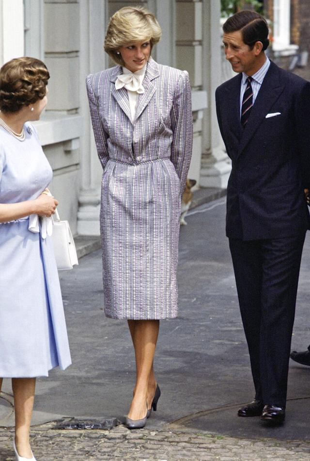 <p>During Diana's lifetime, more and more women joined the workforce, and they struggled with workplace-appropriate attire. Diana gave them guidance with a series of menswear-inspired suit-dresses, like this early version, by designer Bruce Oldfield. (Photo: Tim Graham/Getty Images) </p>