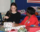 <p>Kate Middleton helps wrap Christmas presents at the Northside Center for Child Development in New York City.</p>