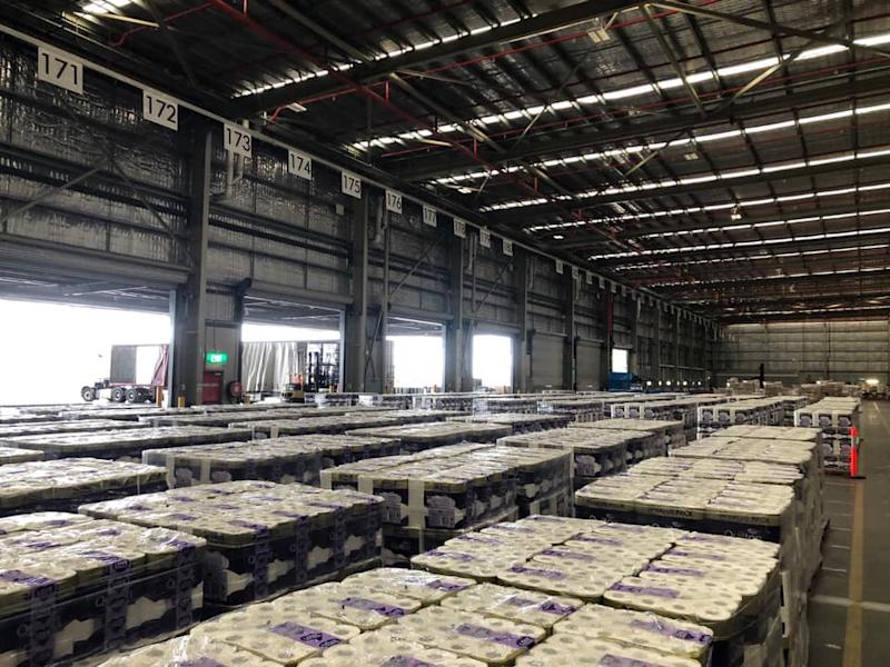 An image of a warehouse full of toilet paper can be seen.