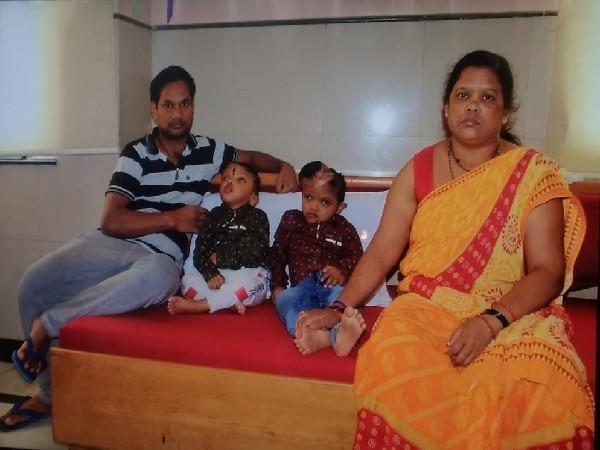 The twins from Odisha with their parents. (File photo/ANI)