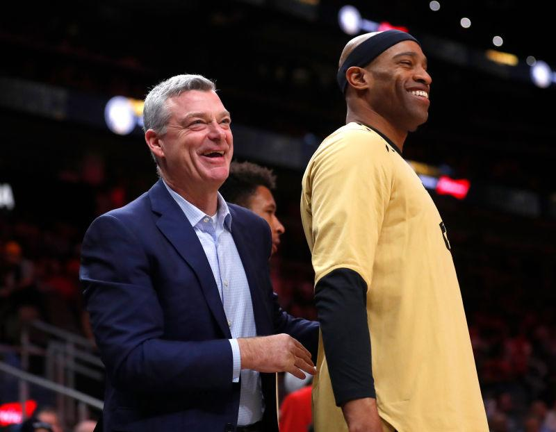 Atlanta Hawks owner Tony Ressler, left, speaks to forward Vince Carter before an NBA basketball game against the Indiana Pacers Wednesday, April 10, 2019, in Atlanta.