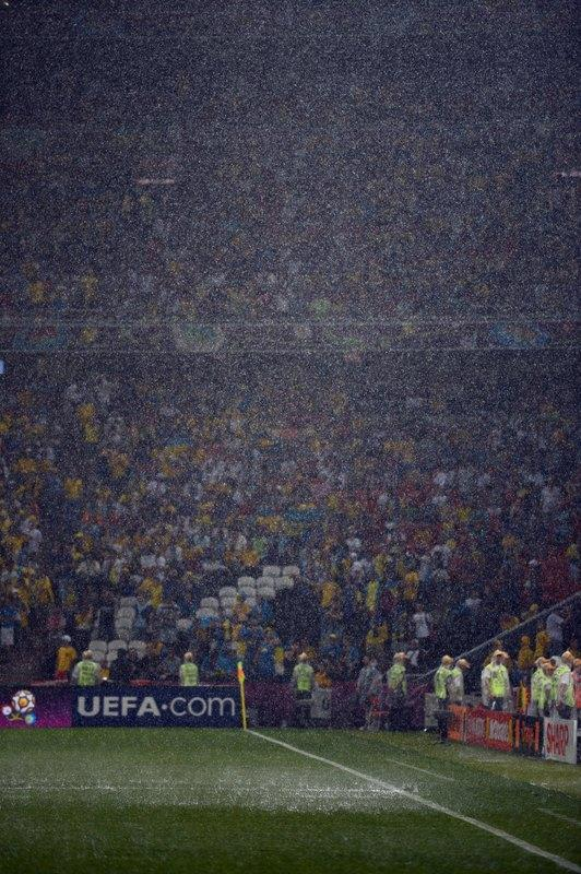 The rain falls at the Donbass Arena in Donetsk as the Euro 2012 championships football match Ukraine vs France has been suspended because of bad weather conditions, on June 15, 2012.       AFP PHOTO / SERGEI SUPINSKYPATRICK HERTZOG/AFP/GettyImages