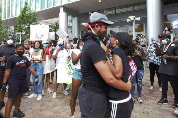 PHOTO: Xavier Young embraces his new fiance, Marjorie Alston, after proposing to her during a protest in Raleigh, N.C., on May 30, 2020. (Charles Crouch/@4CVISUALSGROUP)