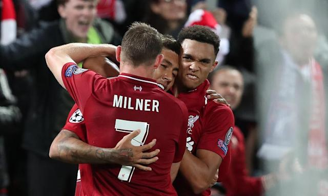 """<span class=""""element-image__caption"""">James Milner and Trent Alexander-Arnold celebrate with Roberto Firmino after his dramatic late winner.</span> <span class=""""element-image__credit"""">Photograph: Paul Greenwood/BPI/Rex/Shutterstock</span>"""