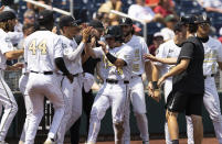 Vanderbilt's CJ Rodriguez (5) celebrates with teammates after scoring off a wild pitch from North Carolina State in the fourth inning during a baseball game in the College World Series, Friday, June 25, 2021, at TD Ameritrade Park in Omaha, Neb. (AP Photo/Rebecca S. Gratz)