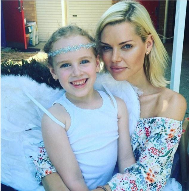 She's already an aunt to her sisters' children, she's pictured here with a niece. Photo: Instagram/Sophie Monk