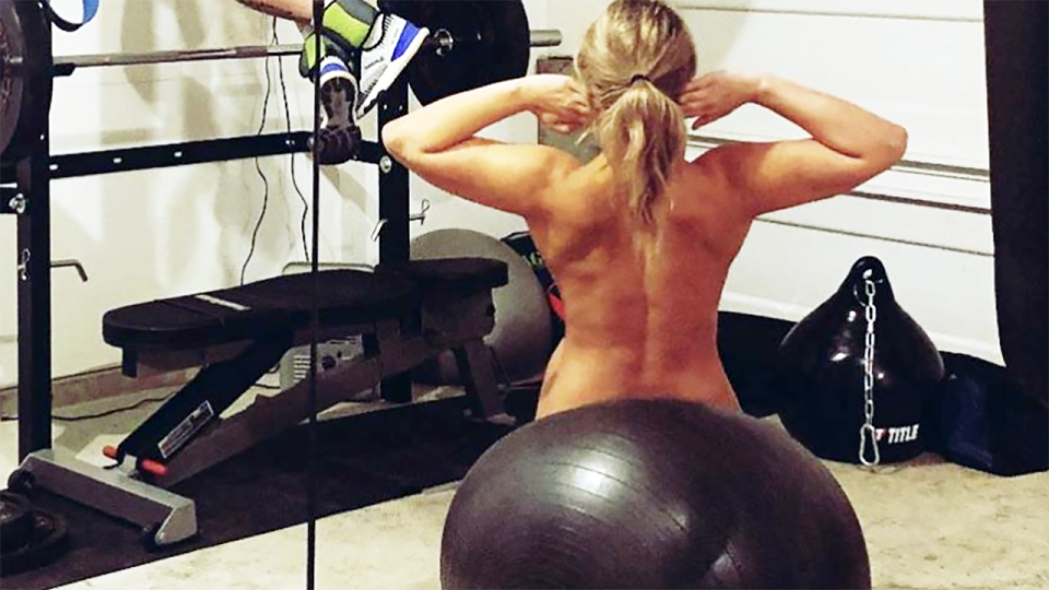 Paige VanZant, pictured here working out in the nude at home.