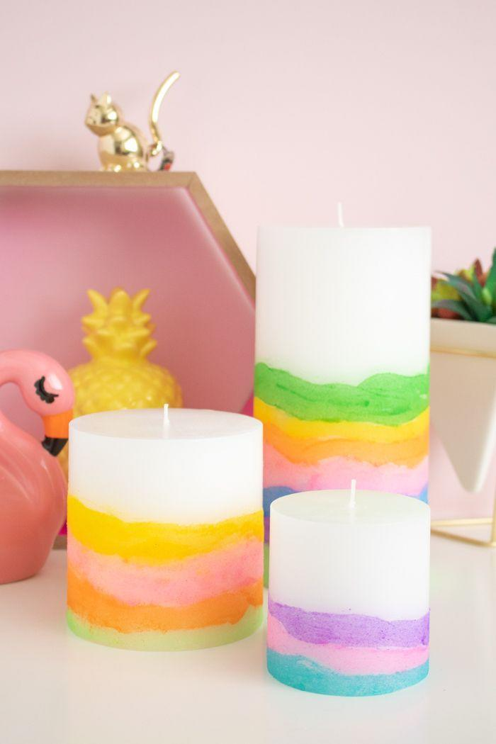 """<p>These colorful candles give sand art kits a run for their money, and Mom will absolutely love putting these on display. </p><p><strong>Get the tutorial at <a href=""""http://www.clubcrafted.com/2018/08/01/diy-sand-art-candles/"""" rel=""""nofollow noopener"""" target=""""_blank"""" data-ylk=""""slk:Club Crafted"""" class=""""link rapid-noclick-resp"""">Club Crafted</a>. </strong></p><p><strong><a class=""""link rapid-noclick-resp"""" href=""""https://www.amazon.com/Colored-Scenic-Sheets-Painting-Children/dp/B076P4SQ6B/?tag=syn-yahoo-20&ascsubtag=%5Bartid%7C10050.g.4233%5Bsrc%7Cyahoo-us"""" rel=""""nofollow noopener"""" target=""""_blank"""" data-ylk=""""slk:SHOP SAND ART KITS"""">SHOP SAND ART KITS</a><br></strong></p>"""