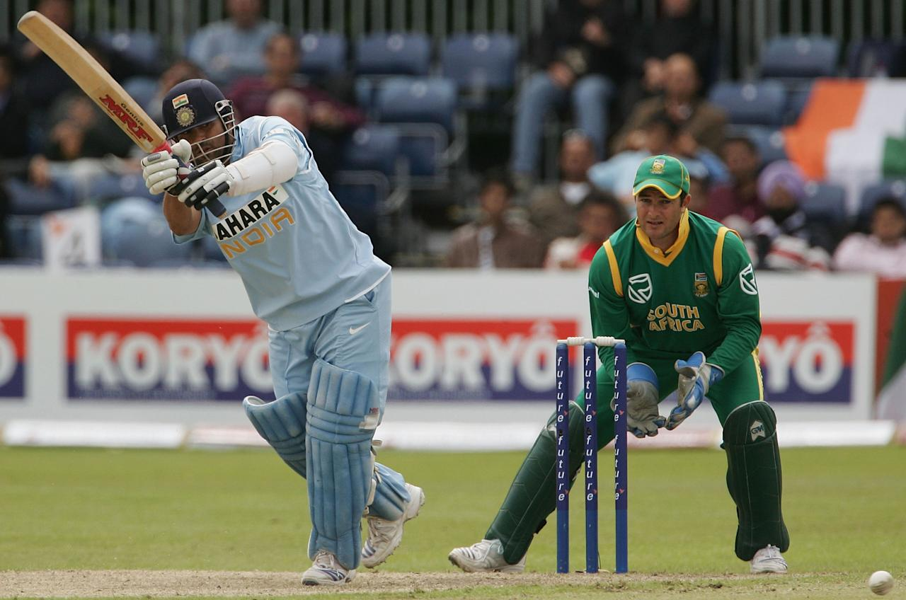 BELFAST, UNITED KINGDOM - JUNE 29:  Sachin Tendulkar of India hits to mid wicket with Mark Boucher of South Africa looking on during the second One Day International match between South Africa and India at the Civil Service Cricket Club in Stormont on June 29, 2007 in Belfast, Northern Ireland.  (Photo by Hamish Blair/Getty Images)