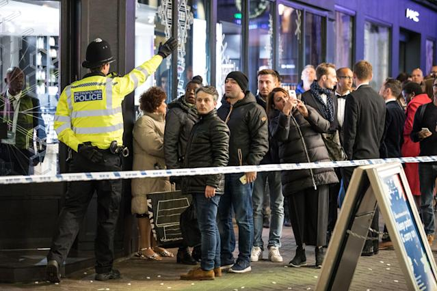 <p>A policeman directs the public away from a police cordon on London's Carnaby Street as police deal with an incident at Oxford Circus on Nov. 24, 2017. (Photo: Rob Pinney/LNP/REX/Shutterstock) </p>
