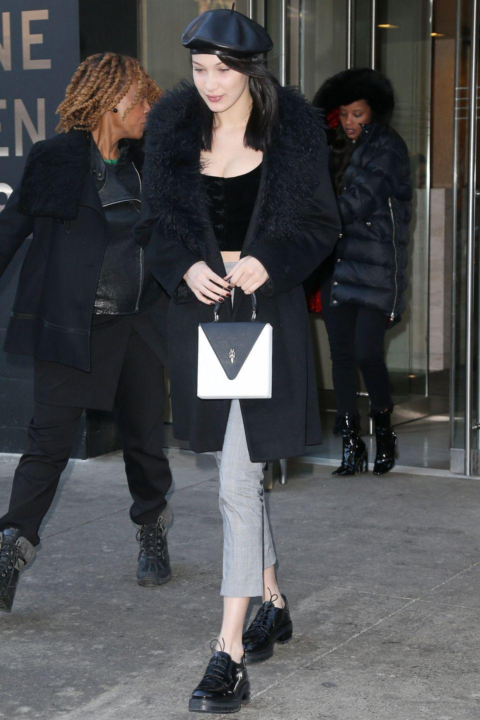 <p>In a leather beret, black fur coat, button-up crop top, light gray plaid trousers, patent leather oxfords and a Chrome Hearts bag while out in New York.</p>