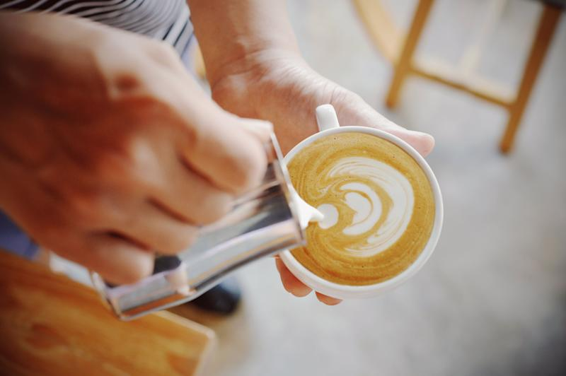 A picture of a barista pouring a flat white coffee. Melbourne cafe owner Mark Dundon believes the cost of coffee could go up to $7 a cup because of climate change affecting plantations.