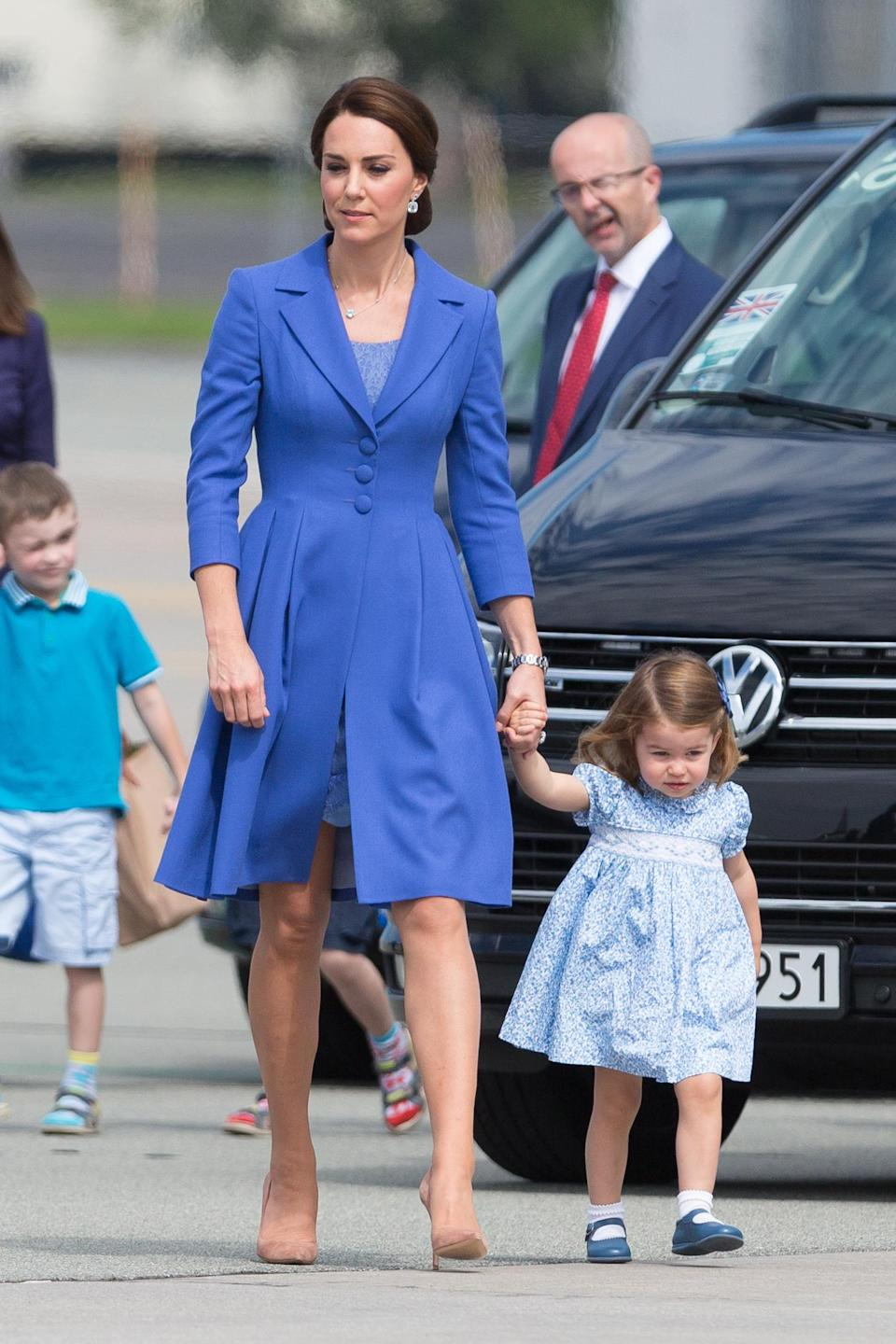 Kate and Charlotte in similar blue tones in Germany in 2017. Source: Getty