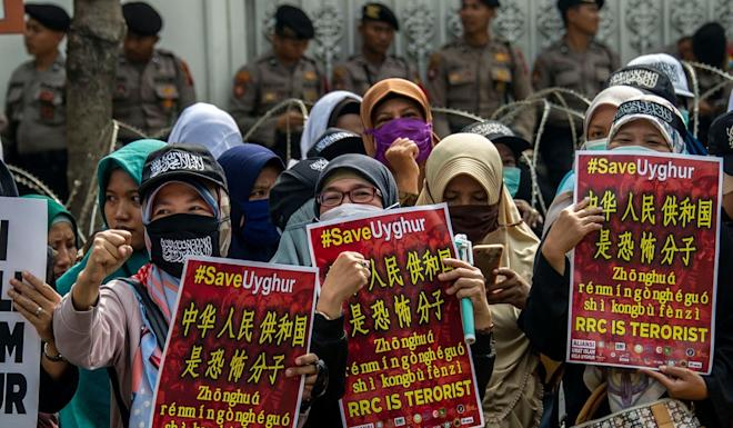 Muslim stage an anti-China rally in front of the Chinese consulate in Surabaya, East Java, last month. Photo: AFP