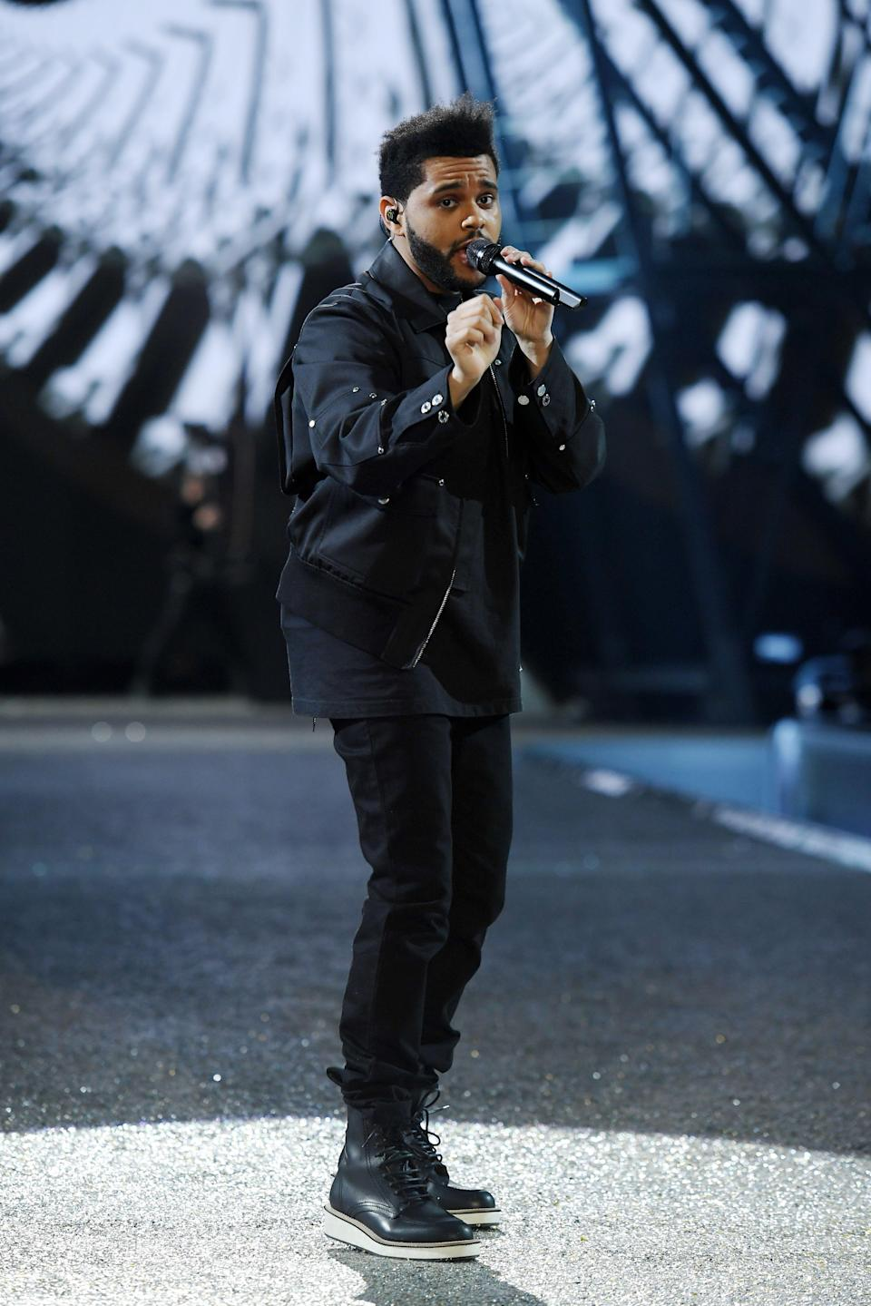 """<p><a href=""""https://www.cosmopolitan.com/entertainment/celebs/a35266086/the-weeknd-net-worth/"""" rel=""""nofollow noopener"""" target=""""_blank"""" data-ylk=""""slk:The Weeknd"""" class=""""link rapid-noclick-resp"""">The Weeknd</a> is easily one of the biggest stars of our generation, and after listening through the stack of albums he's blessed fans with, it feels like he can do no wrong. The Weeknd is on the track to legend status—he's going to be taking the stage during Super Bowl LV for the Pepsi Halftime Show next month, which p much catapults any performer into serious levels of superstardom. As the kids say, it's free real estate. (Literally, because <a href=""""https://www.cosmopolitan.com/entertainment/tv/a30752231/why-jennifer-lopez-shakira-not-paid-super-bowl-halftime-show/"""" rel=""""nofollow noopener"""" target=""""_blank"""" data-ylk=""""slk:Abel likely won't make a single cent"""" class=""""link rapid-noclick-resp"""">Abel likely won't make a single cent</a>, but uh, more on that later 😬).</p><p>Before The Weeknd was...well, The Weeknd, he was Abel Tesfaye—a newcomer to the world of R&B who <a href=""""https://www.businessinsider.com/how-the-weeknd-got-his-start-on-youtube-2015-8"""" rel=""""nofollow noopener"""" target=""""_blank"""" data-ylk=""""slk:anonymously posted videos on YouTube under the name &quot;xoxxxoooxo."""" class=""""link rapid-noclick-resp"""">anonymously posted videos on YouTube under the name """"xoxxxoooxo.</a>"""" We now know the new Abel as a pop hit-making machine, but in all honesty, some of his best songs are actually hella moody—no offense to <em><a href=""""https://www.cosmopolitan.com/entertainment/music/a30998500/the-weeknd-after-hours-bella-hadid-lyrics-explained/"""" rel=""""nofollow noopener"""" target=""""_blank"""" data-ylk=""""slk:After Hours"""" class=""""link rapid-noclick-resp"""">After Hours</a></em> or <em>Starboy</em>. Since you deserve to know all of Abel's hits (and not just the mainstream ones), I've completed my civic duty by ranking all of his best bops. It was not an easy task, but hey, someone's gotta do it. ¯\_(ツ)_/¯</p"""