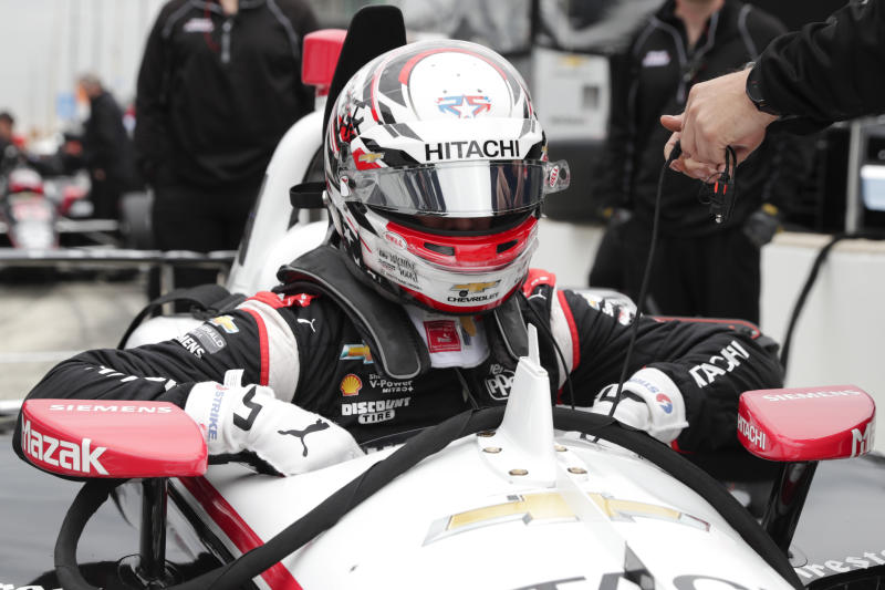 The Advanced Frontal Protection device is shown directly in front of IndyCar driver Josef Newgarden as climbs into his car during auto racing testing at the Indianapolis Motor Speedway in Indianapolis, Wednesday, April 24, 2019. (AP Photo/Michael Conroy)