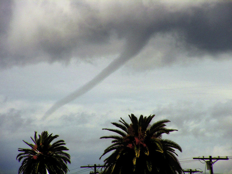 FILE - In this Tuesday, Feb. 22, 2005 file photo, a funnel cloud is seen over the Pacific Ocean off Venice Beach in Los Angeles. On Tuesday, Jan. 10, 2017, a twister touched down south of the state capital and registered EF0, at the lowest edge of the tornado scale that goes up to EF5. The Enhanced Fujita (EF) scale measures the intensity of tornadoes in the U.S. and Canada based on damage caused. (AP Photo/Chris Kim, File)