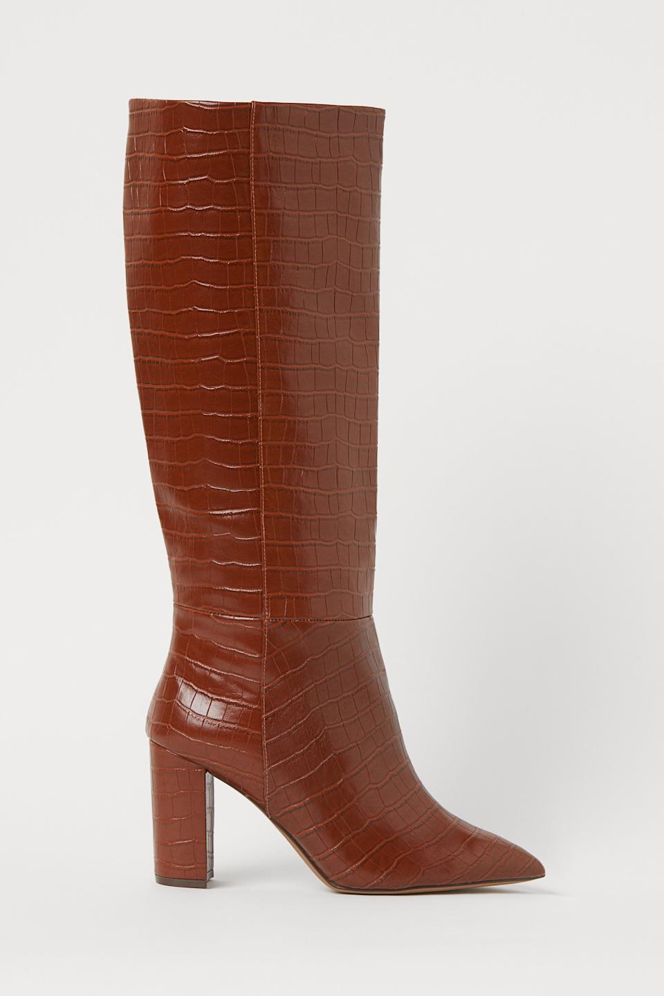 """<strong>— PAID —</strong><br><br>This faux-leather pair has a satin lining made from recycled polyester, which makes for an easy-on, easy-off experience — <em>and</em> feeling good about your fashion choices.<br><br><strong>H&M</strong> Crocodile-patterned Boots, $, available at <a href=""""https://go.skimresources.com/?id=30283X879131&url=https%3A%2F%2Fwww2.hm.com%2Fen_us%2Fproductpage.0898886002.html"""" rel=""""nofollow noopener"""" target=""""_blank"""" data-ylk=""""slk:H&M"""" class=""""link rapid-noclick-resp"""">H&M</a>"""