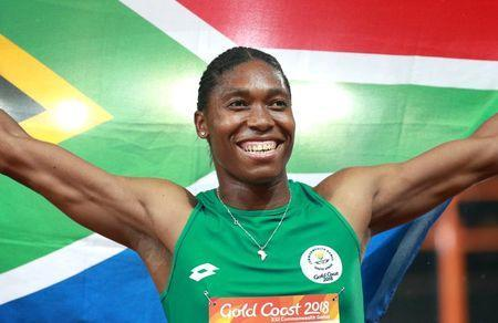 Gold medalist Caster Semenya of South Africa celebrates. REUTERS/Athit Perawongmetha