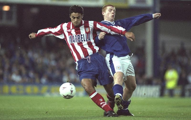 Neil Lennon battles for the ball against Atletico 20 years ago - Getty Images Europe