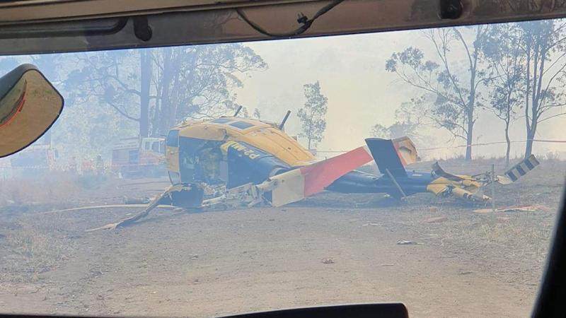 The crumpled helicopter is seen sitting heaped on the ground.Source: supplied