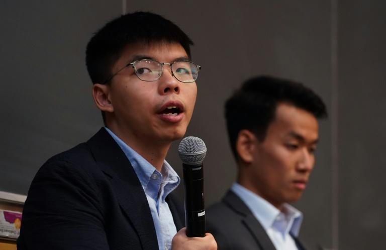 """Democracy activist Joshua Wong (left), with graduate student Brian Leung, attended a panel on """"Anti-Extradition Law Movement"""" in New York"""