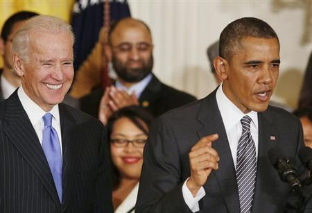 U.S. President Obama speaks about immigration reform next to U.S. Vice President Biden in the East Room at the White House in Washington