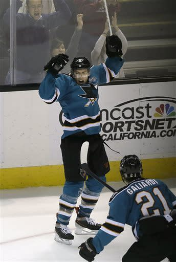San Jose Sharks center Joe Pavelski (8) celebrates after scoring a goal with left wing T.J. Galiardi (21) during the third period of an NHL hockey game against the Calgary Flames in San Jose, Calif., Friday, April 5, 2013. The Sharks won 2-1. (AP Photo/Jeff Chiu)
