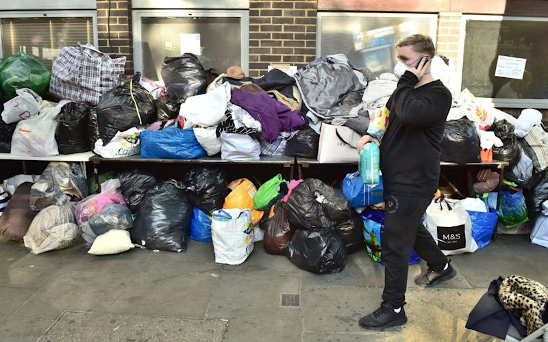 Donations outside Latymer Community Church after a fire engulfed Grenfell Tower in west London - Credit: PA