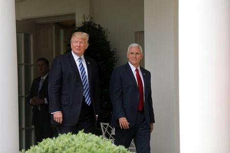 U.S. President Donald Trump and Vice President Mike Pence attend a National Day of Prayer event at the Rose Garden of the White House in Washington D.C., U.S., May 4, 2017. REUTERS/Carlos Barria