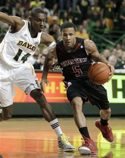 Texas Tech 's Javarez Willis (5) drives past Baylor 's Deuce Bello (14) in the first half of an NCAA college basketball game Monday, Feb. 27, 2012, in Waco, Texas. (AP Photo/Tony Gutierrez)