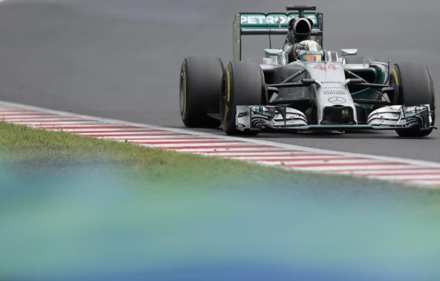 Mercedes driver Lewis Hamilton of Britain steers his car during the Hungarian Formula One Grand Prix in Budapest, Hungary, Sunday, July 27, 2014. (AP Photo/Petr David Josek)