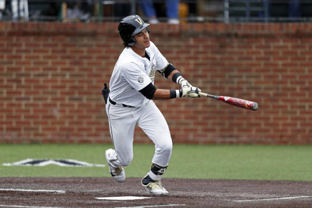 In this May 11, 2019, photo, Vanderbilt's Austin Martin connects for a hit during an NCAA college baseball game against Missouri in Nashville, Tenn. Vanderbilt's blazing second half of the season has turned it into one of the favorites to win the Southeastern Conference tournament this week in Hoover, Alabama. Arkansas, Georgia and Mississippi State are also among the top seeds when the games begin Tuesday, May 21. (AP Photo/Wade Payne)