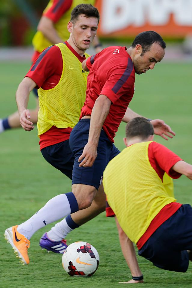 United States' Landon Donavan fights for the ball with Matt Besler, left, during a training session in Sao Paulo, Brazil, Tuesday, Jan. 14, 2014. The US national soccer team is on a training program in Sao Paulo preparing for the World Cup tournament, which gets underway on June. (AP Photo/Nelson Antoine)